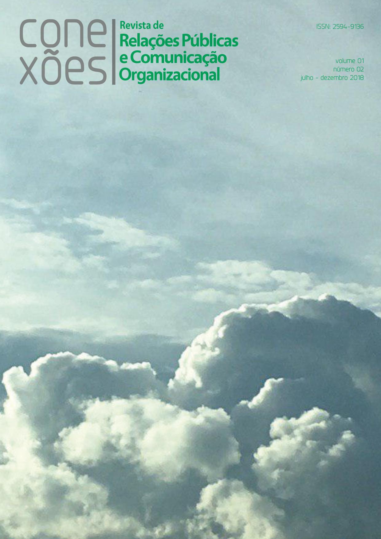 na parte superior da capa contem nome da revista e dados da edição. o fundo da capa é um lindo céu em forma de pintura com nuvens plenas como um delicioso algodão doce.